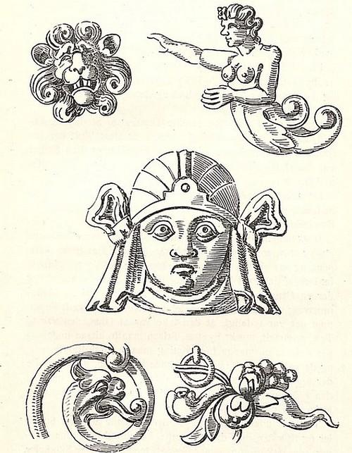 Et lovehoved, en havfrue, et ansigt og et dragehoved